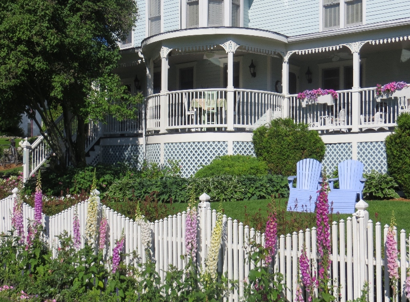 Picket fences with pastel flowers adorn the town on Mackinac Island