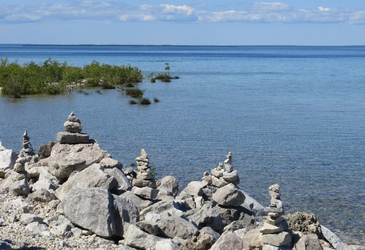 Make your own pebble stacks along the Mackinac beach trails