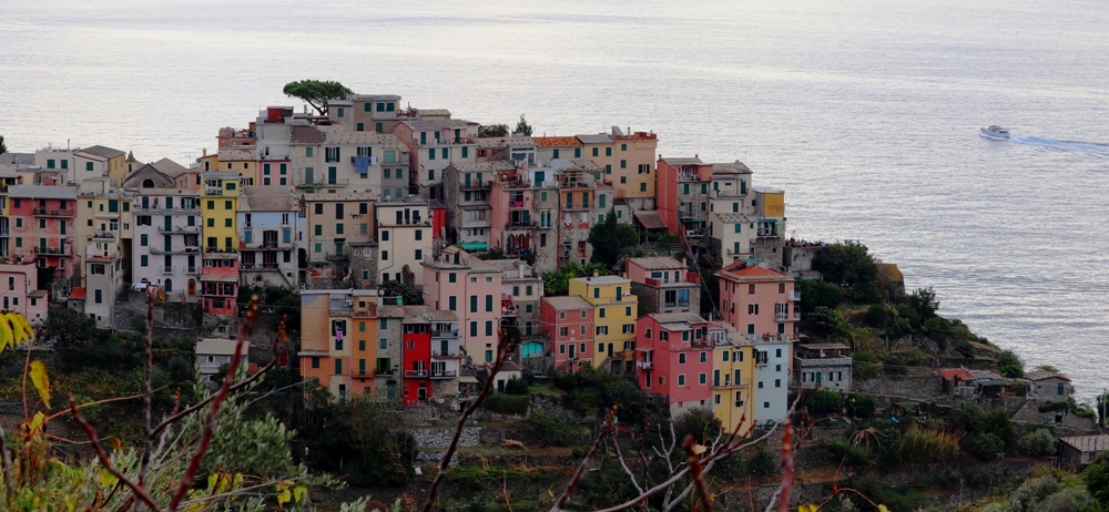 Pastel buildings are set against the Mediterranean sea.