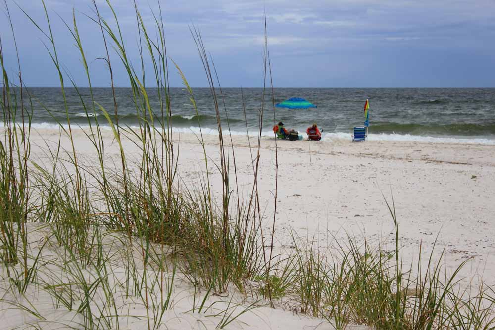 Sea oats and sugar-white sands in Gulf Shores provide relaxation on a fall day