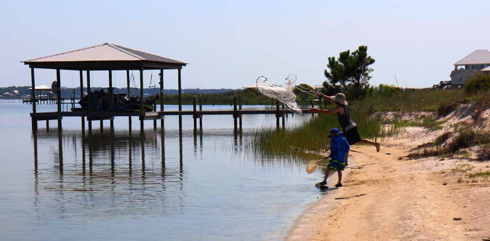Fishing in the shallow waters of Little Lagoon in Gulf Shores, Alabama