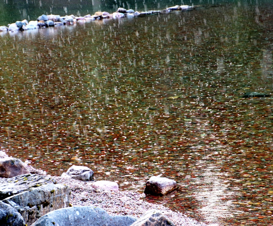 Rain on colored pebbles in Lake McDonald
