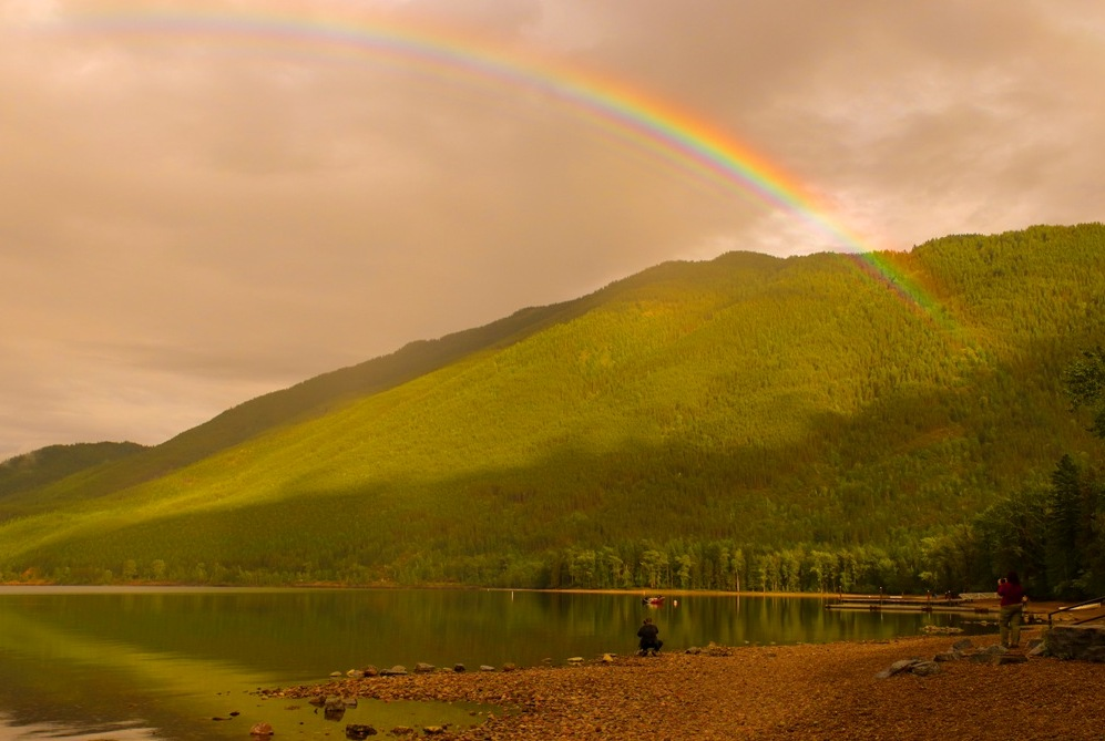Rainbow on Lake McDonald bring photographers to the shore