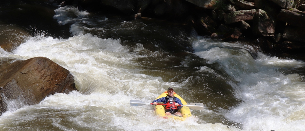 Kayakers test their whitewater skills  around the Nantahala Outdoor Center