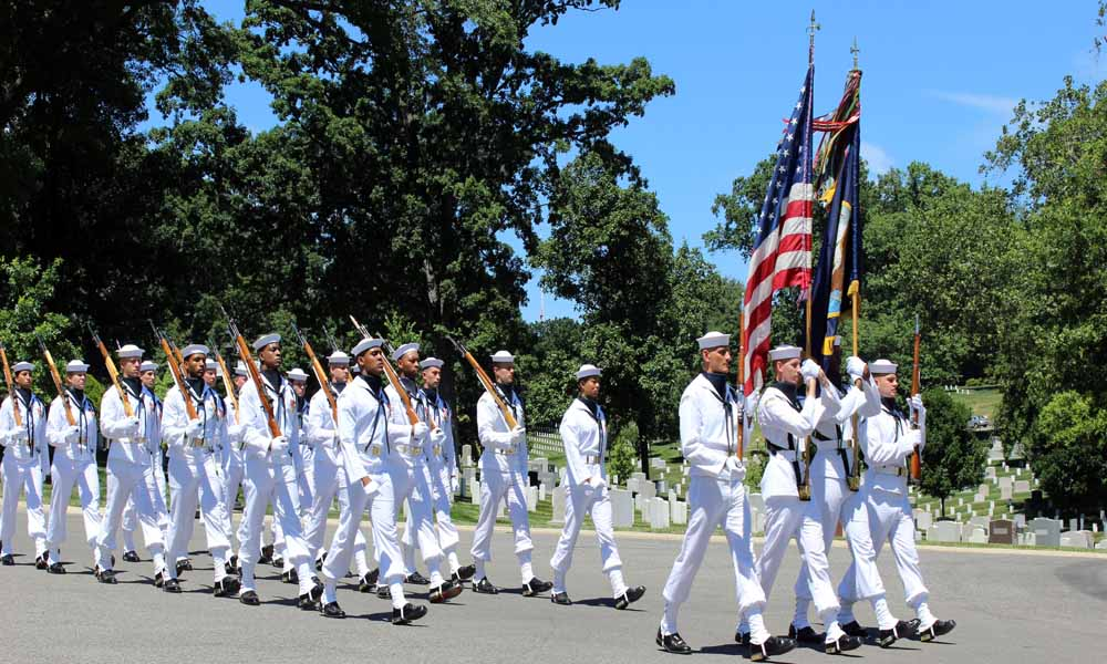 Enlisted service men with rifles are part of the Honor Guard