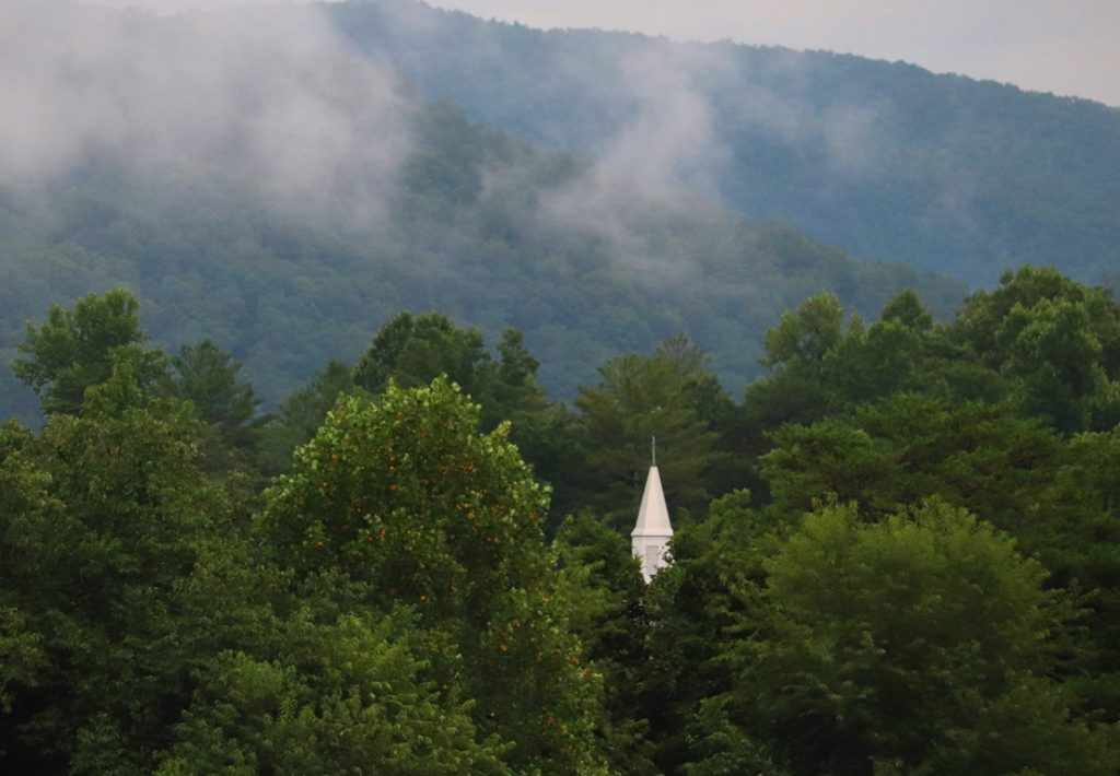 Church steeple nestled into the hills of the Smoky Mountains of Tennessee