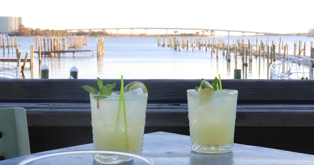 Enjoy cocktails overlooking the bay from Playa at Sportsman Marina